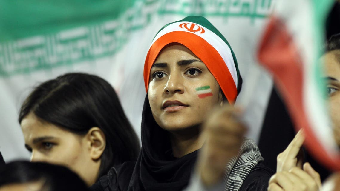 Iranian young woman fans watch their team winning during their 2014 World Cup Asian zone qualifying football match between Qatar and Iran at the Al-Sadd stadium in Doha on, Tuesday,June, 4, 2013. (AP)