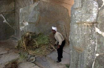 A picture taken on April 21, 2001 near Mosul shows an Iraqi worker cleaning up the archaeological site of Nimrud. (AFP)