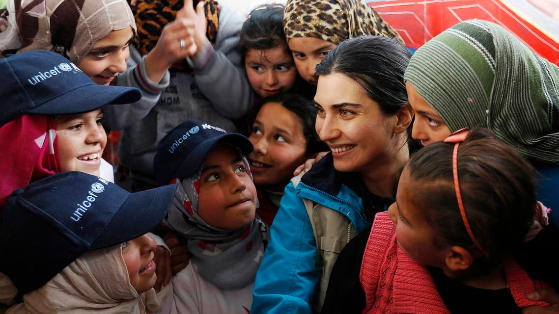 Turkish actress Tuba Buyukustun (3rd R), goodwill ambassador for UNICEF, speaks with Syrian refugee children as she visits a UNICEF centre at the Zaatari refugee camp, in the Jordanian city of Mafraq, near the border with Syria March 4, 2015. Reuters