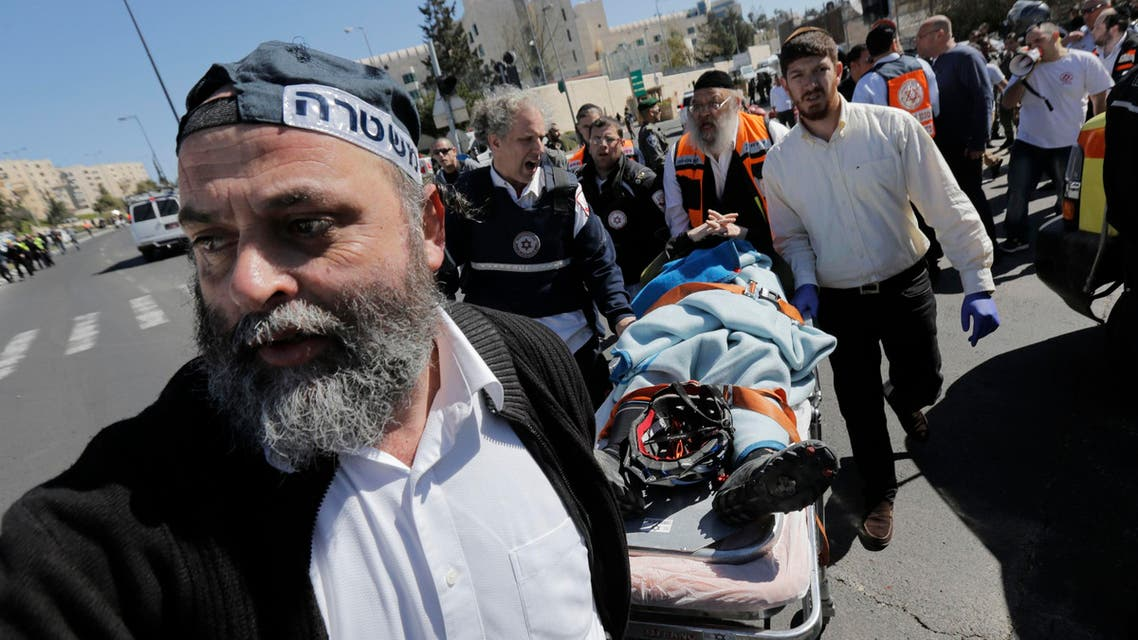 An Israeli policeman and medics evacuate an injured person at the scene of an attack in Jerusalem March 6, 2015. (Reuters)