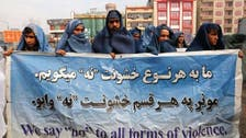 Afghan men wear burqas in Kabul to mark International Women's Day