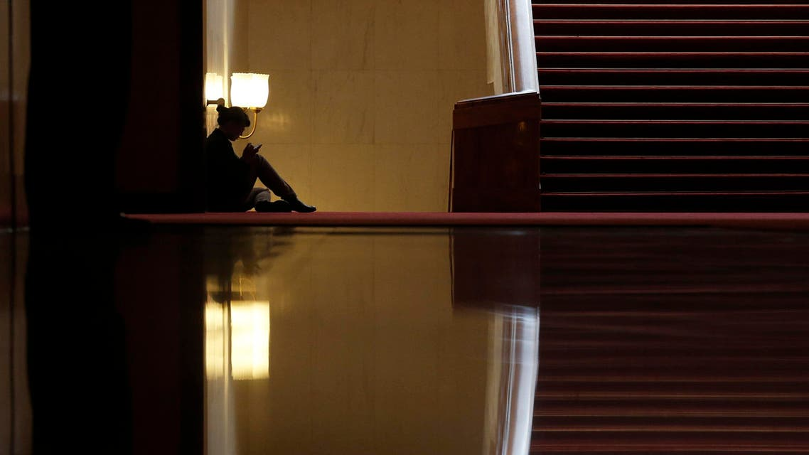 A woman sits inside the Great Hall of the People during the opening session of the Chinese People's Political Consultative Conference (CPPCC) in Beijing, March 3, 2015. (File photo: Reuters)