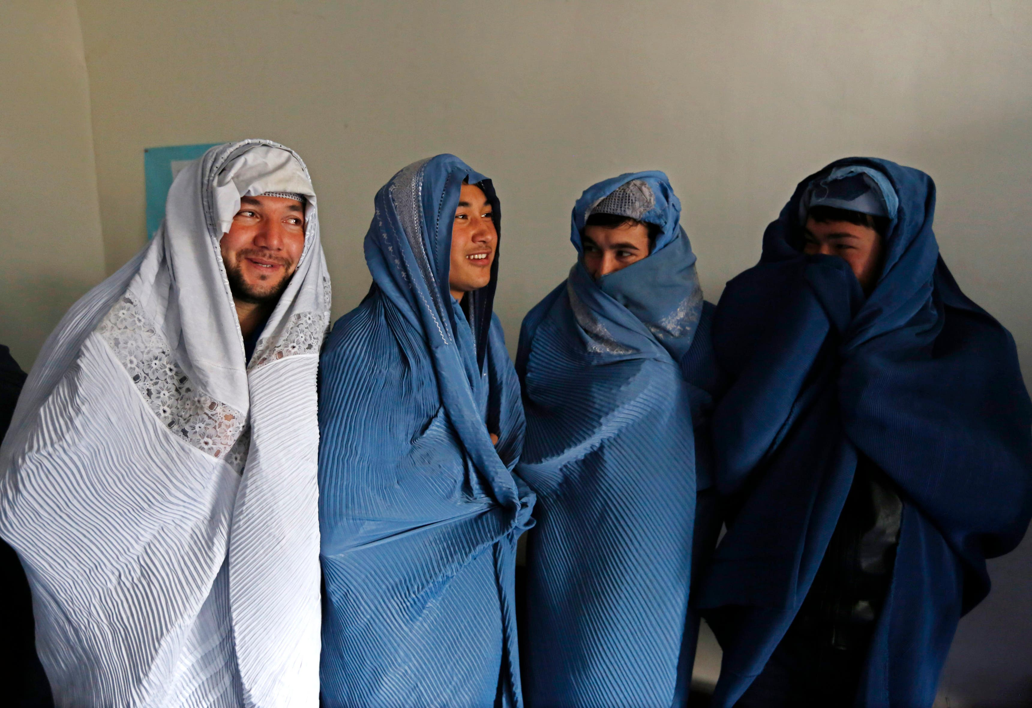 Men don burqas for women's rights