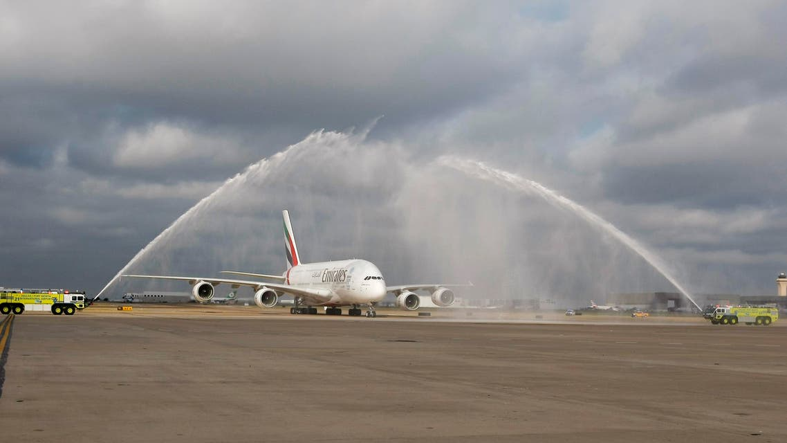 Emirates' inaugural A380 to Dallas/Fort Worth is welcomed by a ceremonial water cannon, Wednesday, Oct. 1, 2014 at Dallas-Fort Worth International Airport in Texas. (AP)