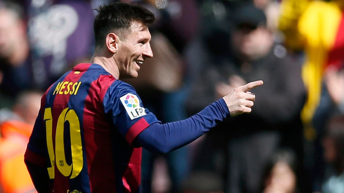 Barcelona's Lionel Messi celebrates a goal against Rayo Vallecano during their Spanish first division soccer match at Camp Nou stadium in Barcelona - Reuters