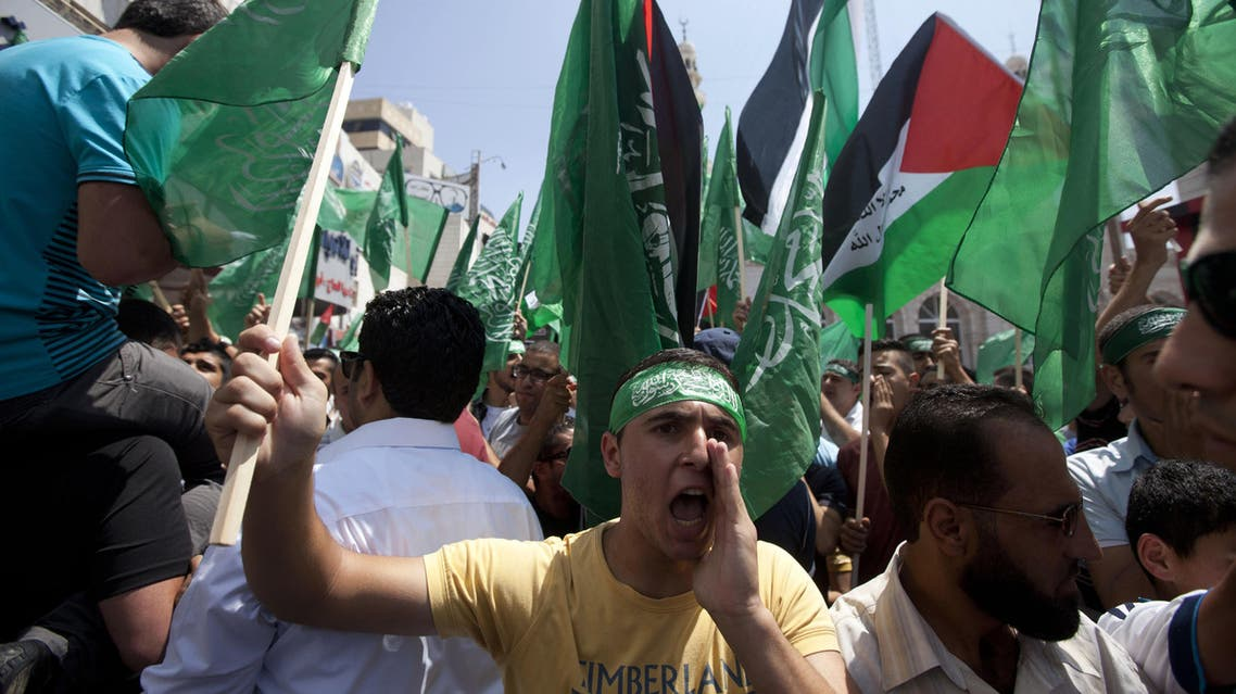 Palestinian Hamas supporter shout slogans to protest against Israel and to support people in Gaza, during a demonstration in the West Bank city of Ramallah, Friday, Aug. 22, 2014. (AP/Majdi Mohammed)