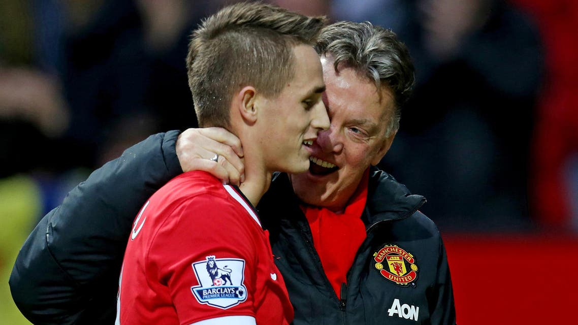 Manchester United manager Louis Van Gaal talks to Adnan Januzaj at the end of the match Action on Feb. 28, 2015. ( Reuters)