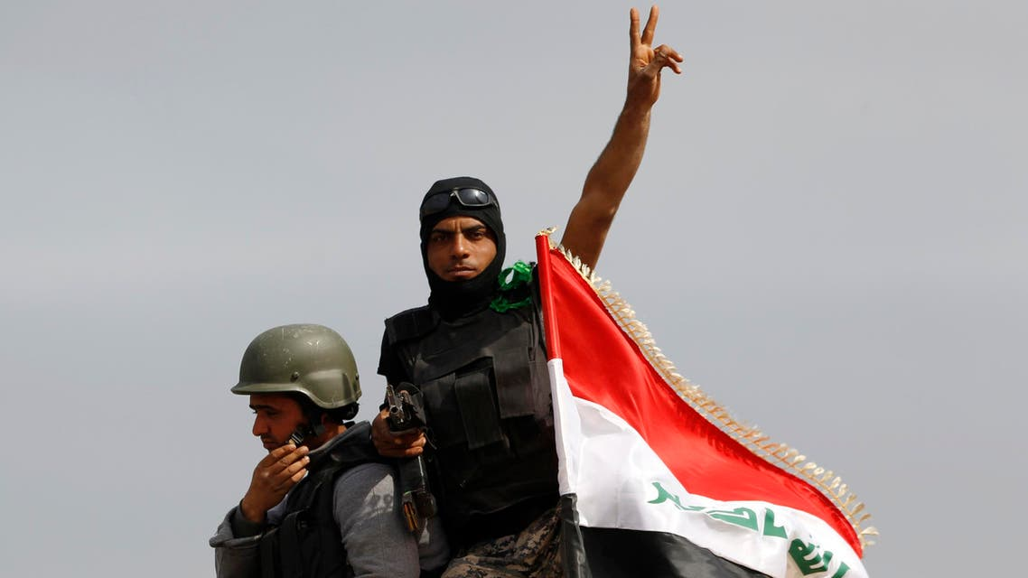 A member of Iraqi security forces gestures in the town of al-Alam, just north of Tikrit. (Reuters)