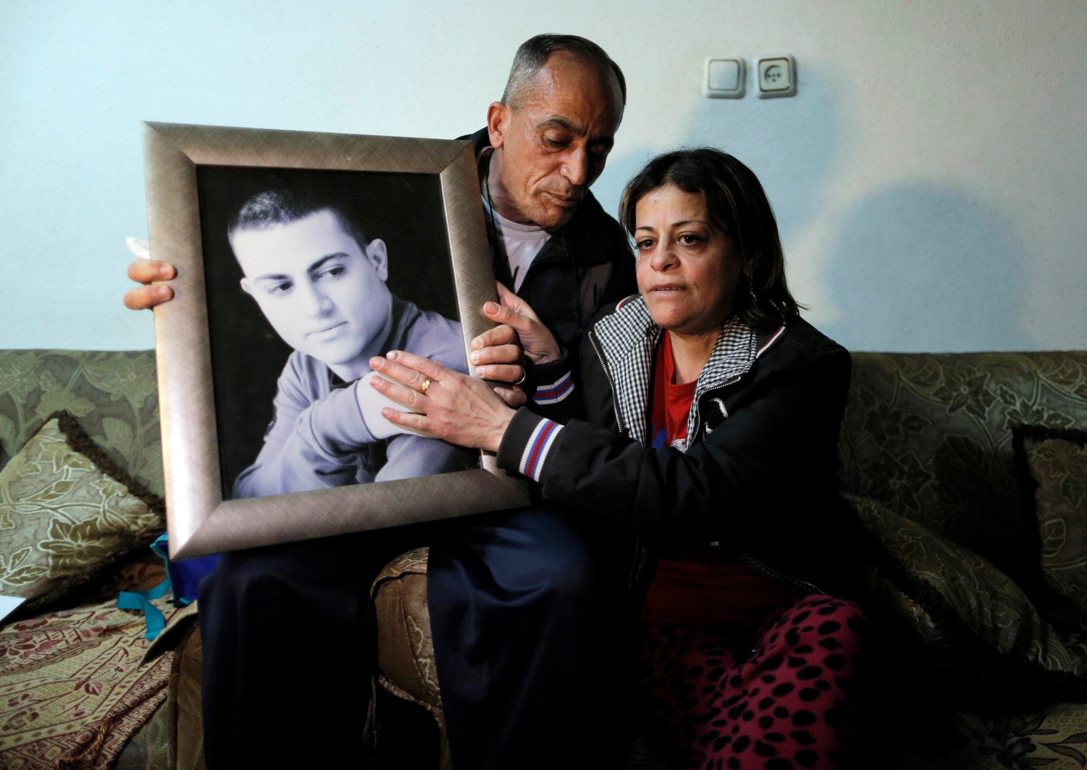 The mother and father of Muhammad Musallam, an Israeli Arab held by ISIS in Syria as an alleged spy, react with a picture of him in their East Jerusalem home March 10, 2015. (Reuters)