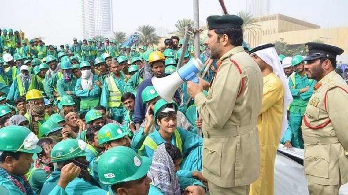Dubai police with construction workers Twitter