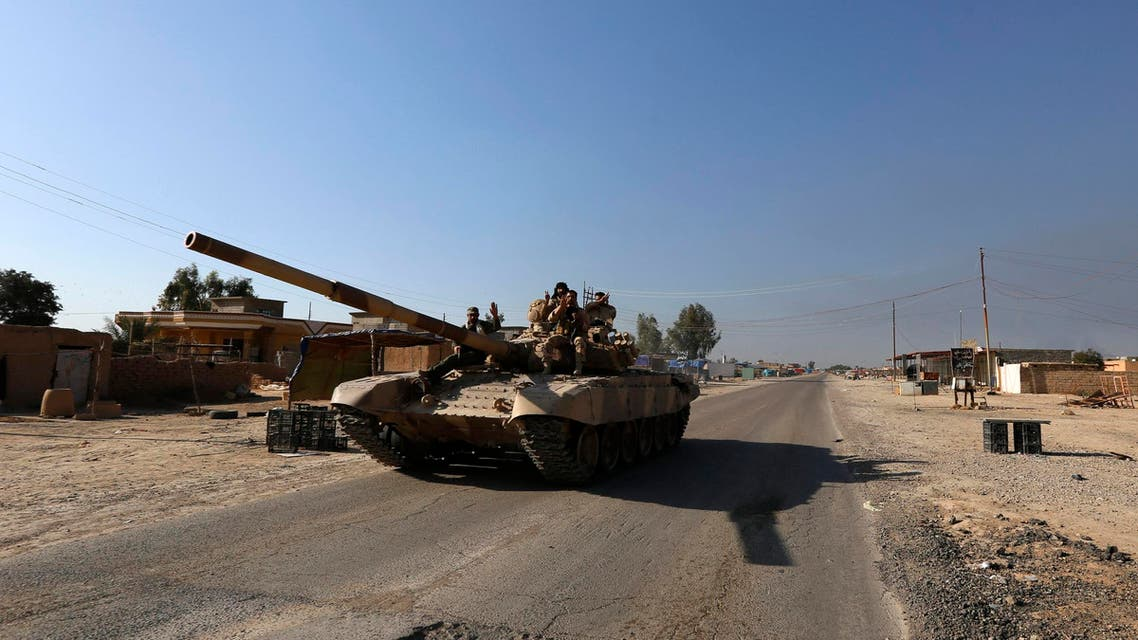 A tank of Iraqi security forces is seen in the town of al-Alam. Reuter s