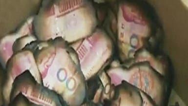 امرأة صينية تحرق ثروة زوجها المخبأة في موقد الحطب