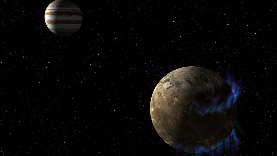 This NASA /ESA artist's concept, obtained March 12, 2015 shows the moon Ganymede as it orbits the giant planet Jupiter. (AFP)