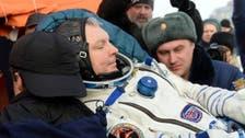 Astronauts return to Earth on Russian Soyuz spaceship