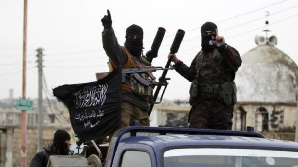 Members of al Qaeda's Nusra Front gesture as they drive in a convoy touring villages, which they said they have seized control of from Syrian rebel factions, in the southern countryside of Idlib, December 2, 2014. (File photo: Reuters)