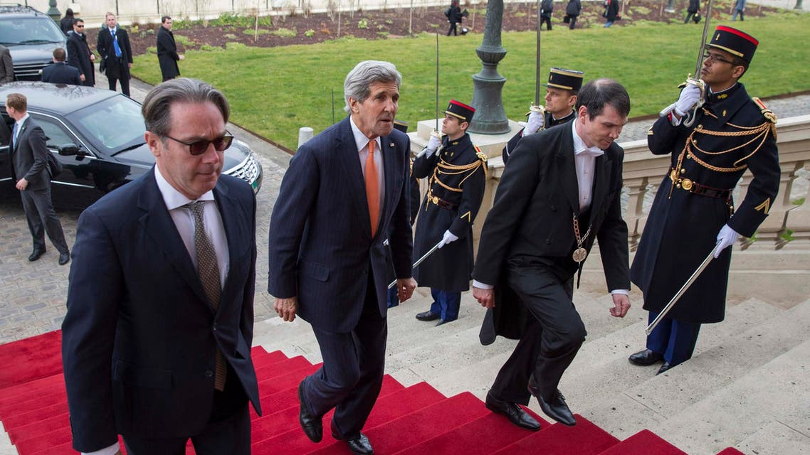 U.S. Secretary of State John Kerry (2nd L) arrives to meet France's Foreign Minister Laurent Fabius in Paris March 7, 2015.  (Reuters)