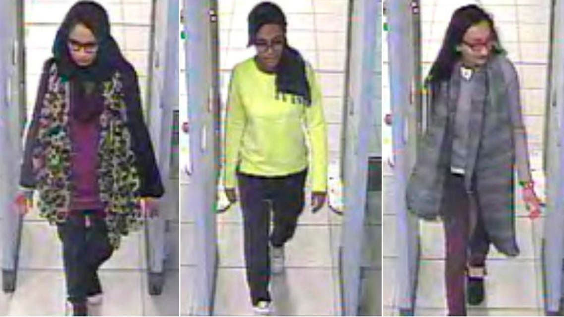 British teenage girls Shamima Begun, Amira Abase and Kadiza Sultana (L-R) walk through security at Gatwick airport before they boarded a flight to Turkey on Feb. 17, 2015. (Reuters)