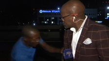 South African reporter mugged while on camera