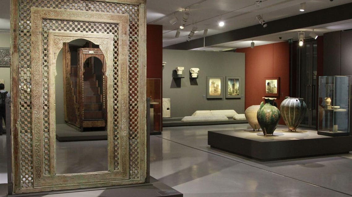 This photo taken March 4, 2015 shows a carved wooden medieval doorway from the Moroccan city of Fez dominating the exhibition room at the Mohammed VI Museum of Modern and Contemporary art in Rabat, Morocco. (AP)