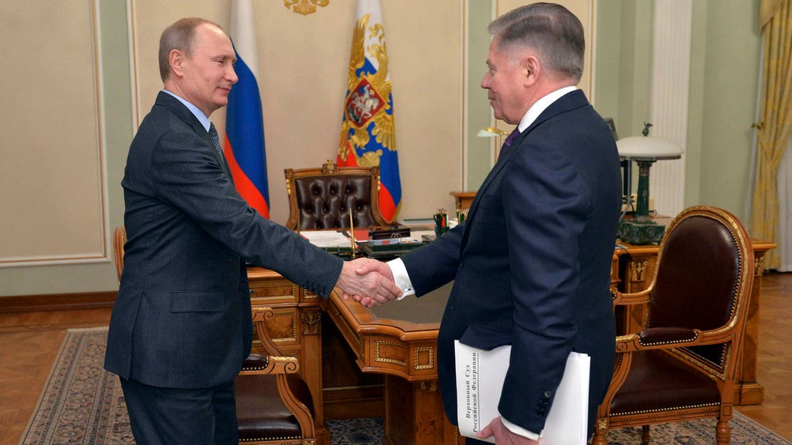 Russian President Vladimir Putin (L) shakes hands with Supreme Court chairman Vyacheslav Lebedev during their meeting at the Novo-Ogaryovo state residence outside Moscow March 13, 2015. (Reuters)