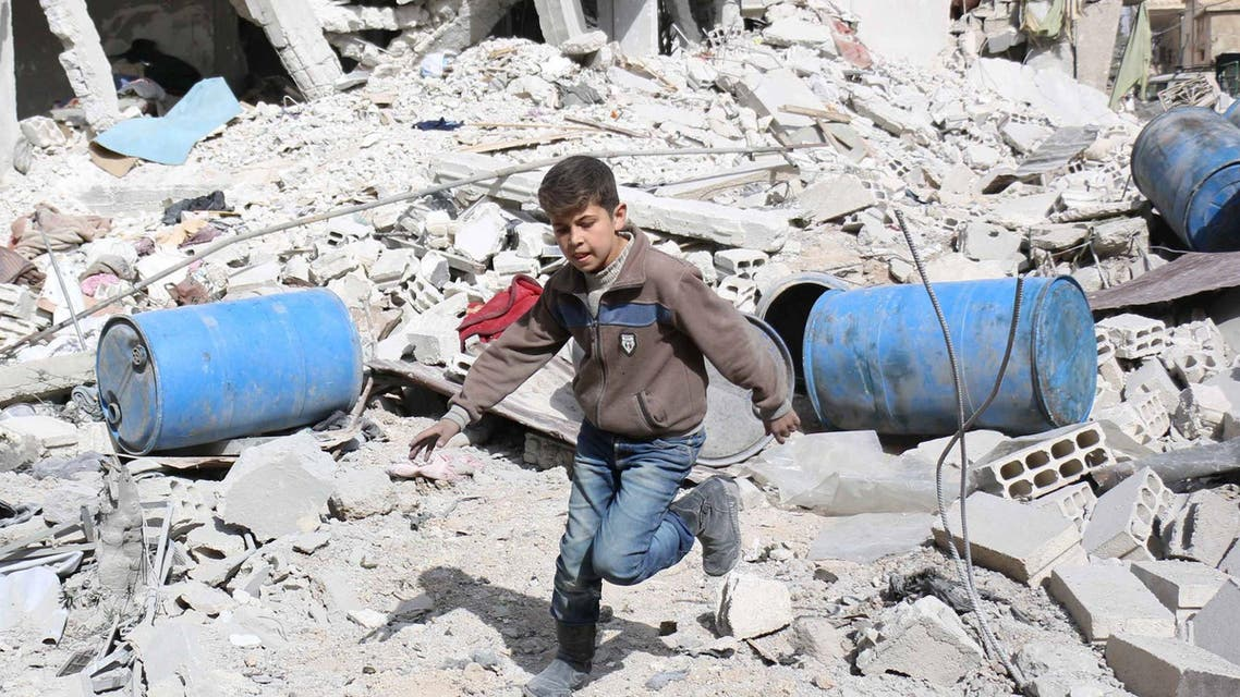 A boy runs over rubble at a site hit on Tuesday by what activists said were airstrikes by forces loyal to Syria's President Bashar al-Assad in the rebel-controlled area near Damascus March 11, 2015.  (Reuters)