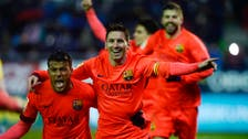 Barca march four points clear at the top