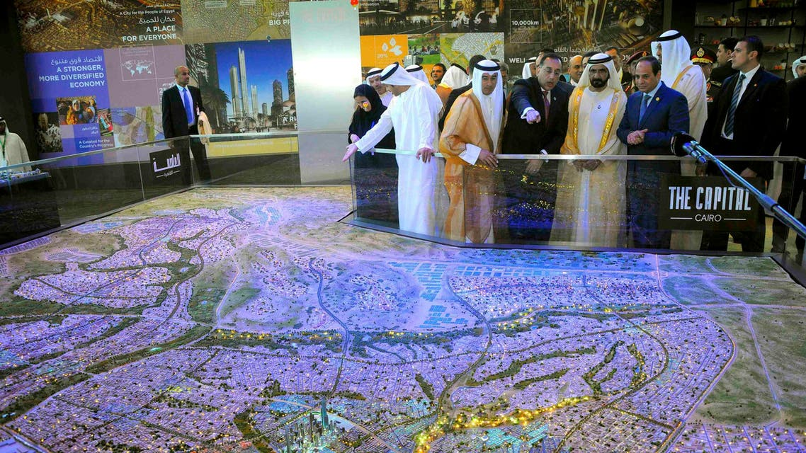 Egyptian President Abdel Fattah al-Sisi (R), United Arab Emirates (UAE) counterpart Sheikh Mohammed bin Rashid al-Maktoum (2nd R), and Egyptian investment minister Ashraf Salman (3rd R) look at a scale model of the new Egyptian capital Cairo displayed at the congress hall in the Red Sea resort of Sharm el-Sheikh, in this March 14, 2015 handout photo. (Reuters)
