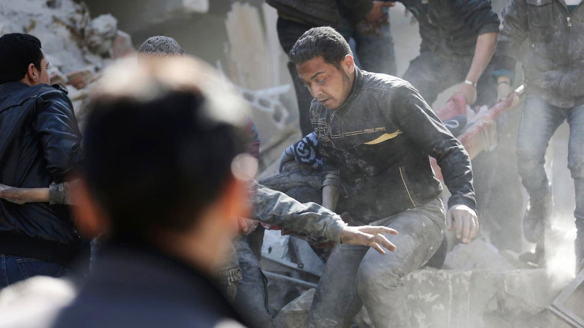 Residents look for survivors amid rubble at a site damaged by what activists said was an air strike by forces loyal to Syria's President Bashar al-Assad in Douma, eastern Al-Ghouta, near Damascus, March 14, 2015.  (Reuters)