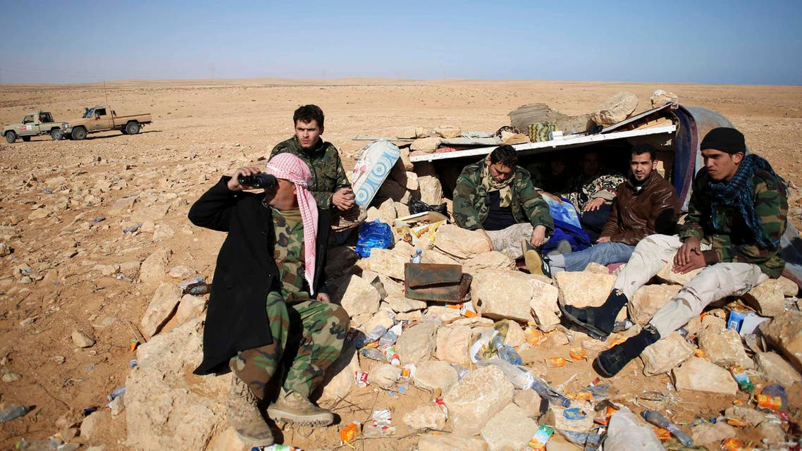 Fighters from Misrata's Marsa Kateeba rest at their positions near the town of Sidre March 8, 2015. (Reuters)