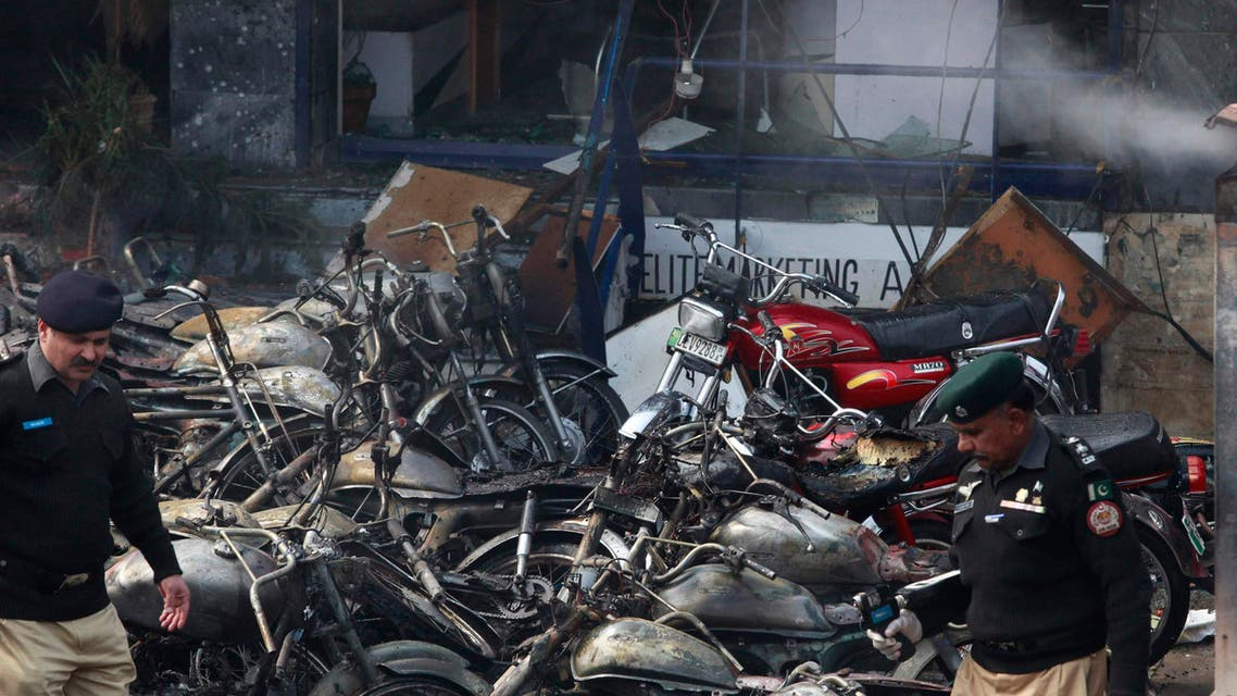 Policemen inspect damaged motorcyles at the site of an explosion outside police headquarters, in Lahore February 17, 2015. (Reuters)