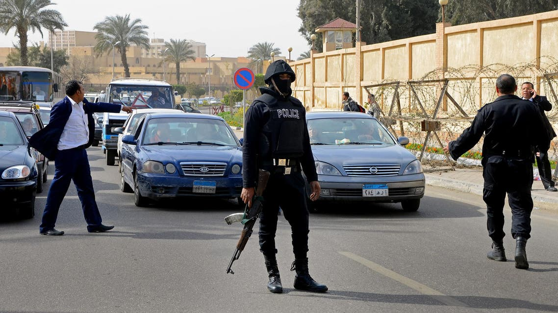 Egyptian security forces block traffic after several bombs were found near Al-Azhar University, Thursday, Feb. 26, 2015. AP