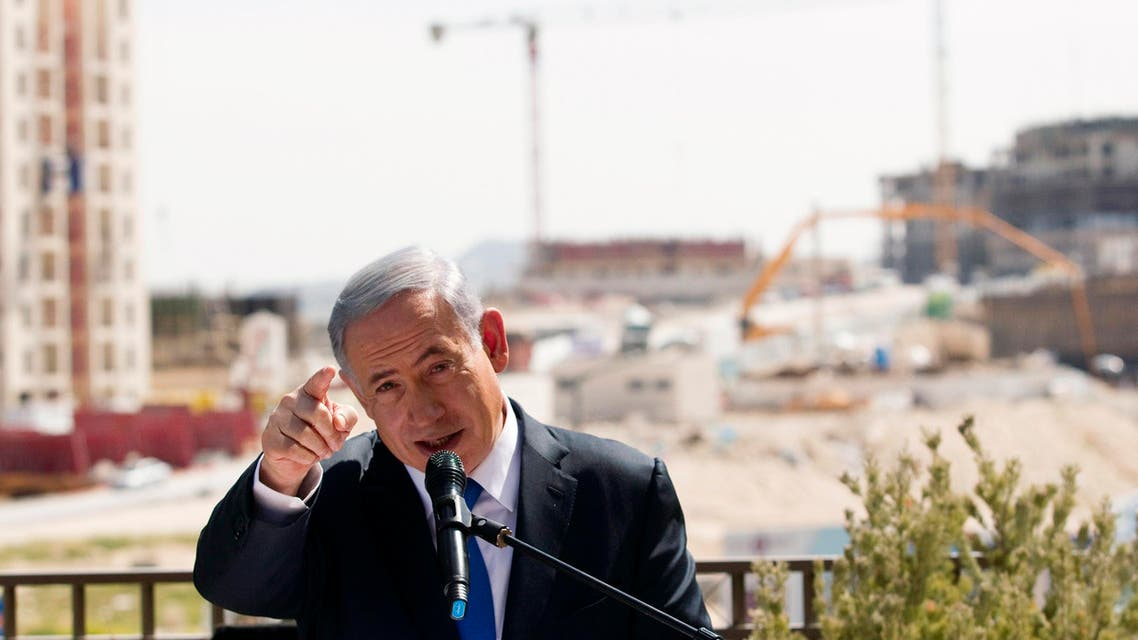 Israeli Prime Minister Benjamin Netanyahu delivers a statement in front of new construction, in the Jewish settlement known to Israelis as Har Homa and to Palestinians as Jabal Abu Ghneim, in an area of the West Bank that Israel captured in a 1967 war and annexed to the city of Jerusalem, March 16, 2015. (Reuters)