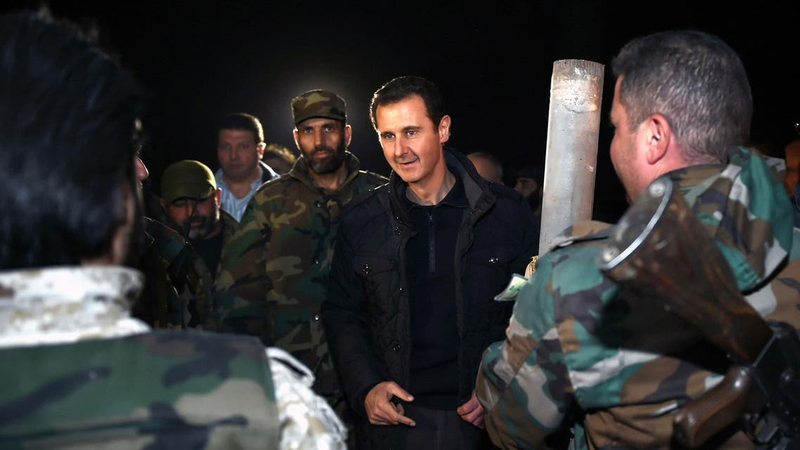 Syrian President Bashar Assad, center, speaks with Syrian troops during his visit on the front line in the eastern Damascus district of Jobar, Syria. (File: AP)