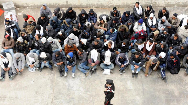 Migrants stranded in boat off Tunisia as centers overcrowded
