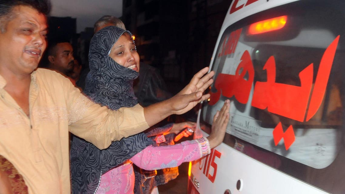 Pakistani relatives mourn beside an ambulance carrying the body of convicted murder Muhammad Faisal after his execution in Karachi on March 17, 2015. AFP