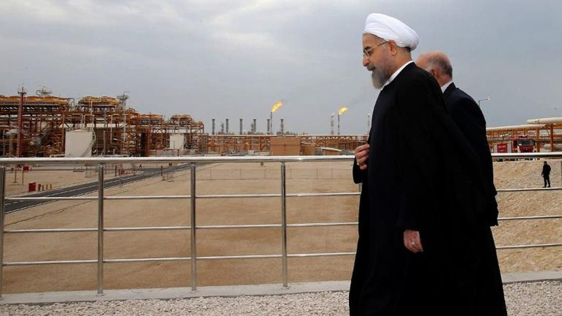 Iranian President Hassan Rouhani shows him (L) walking with Oil Minister Bijan Namdar Zanaganeh (R) at phase 12 of the South Pars gas field facilities in the southern Iranian port of Assaluyeh. (AFP)
