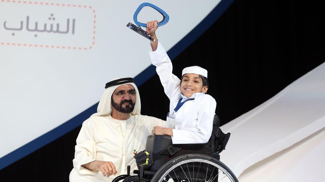 Ghanem al-Muftah, the creator of the Ghanem the Winner Association for Wheelchairs, recieving the Arab Social Media Influencers Award in Dubai, March 17, 2015. (Courtesy: Dubai Media Office)