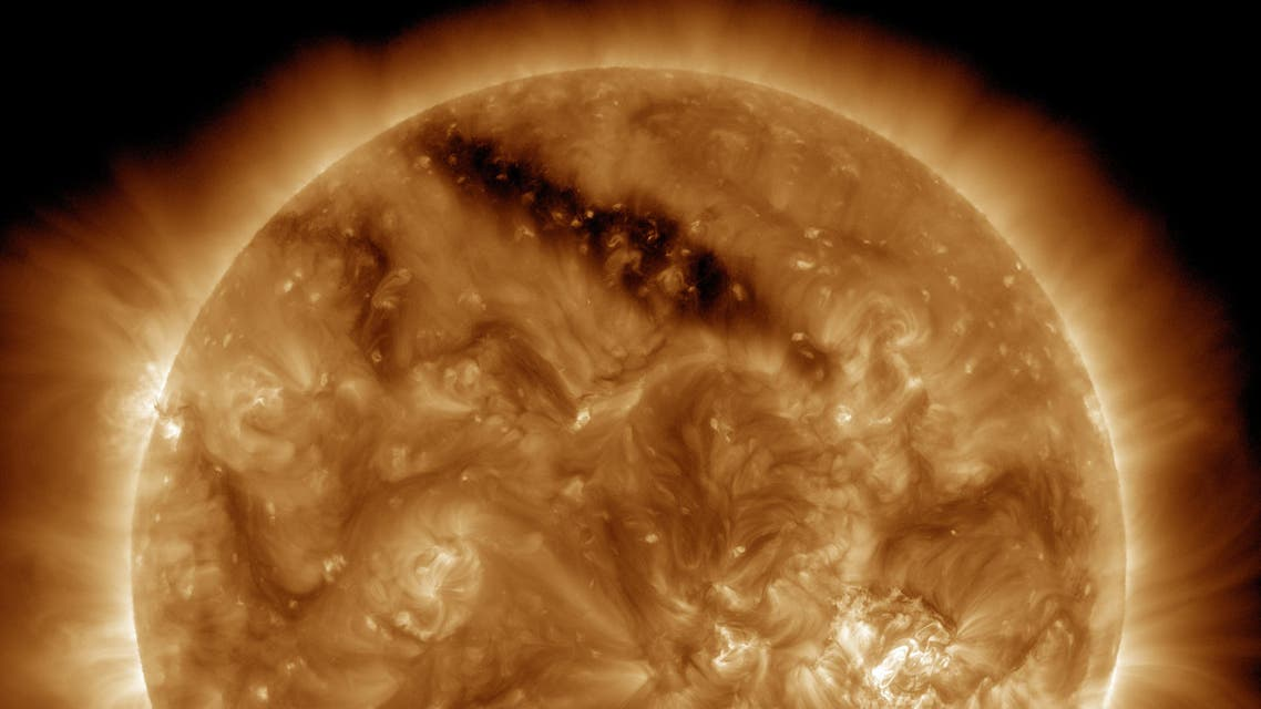 Space agency spots 'holes' in sun's surface (Courtesy of NASA)