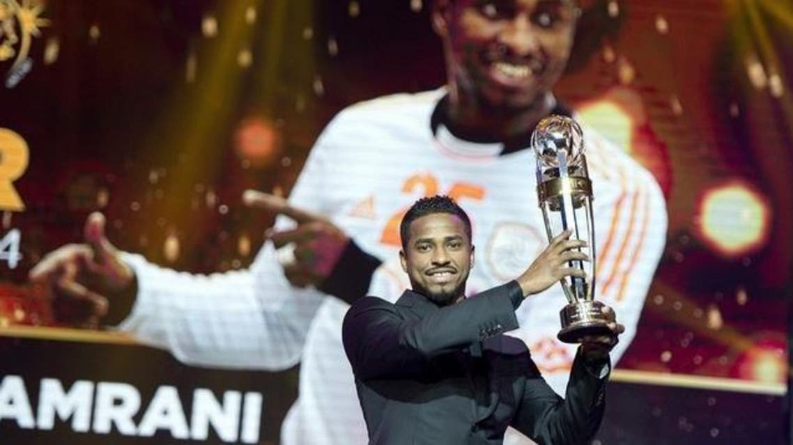 Saudi Arabia Al Hilal striker Nassir Al Shamrani raises the trophy after winning the Asian Football Confederation (AFC) Player of the Year. (AFP)