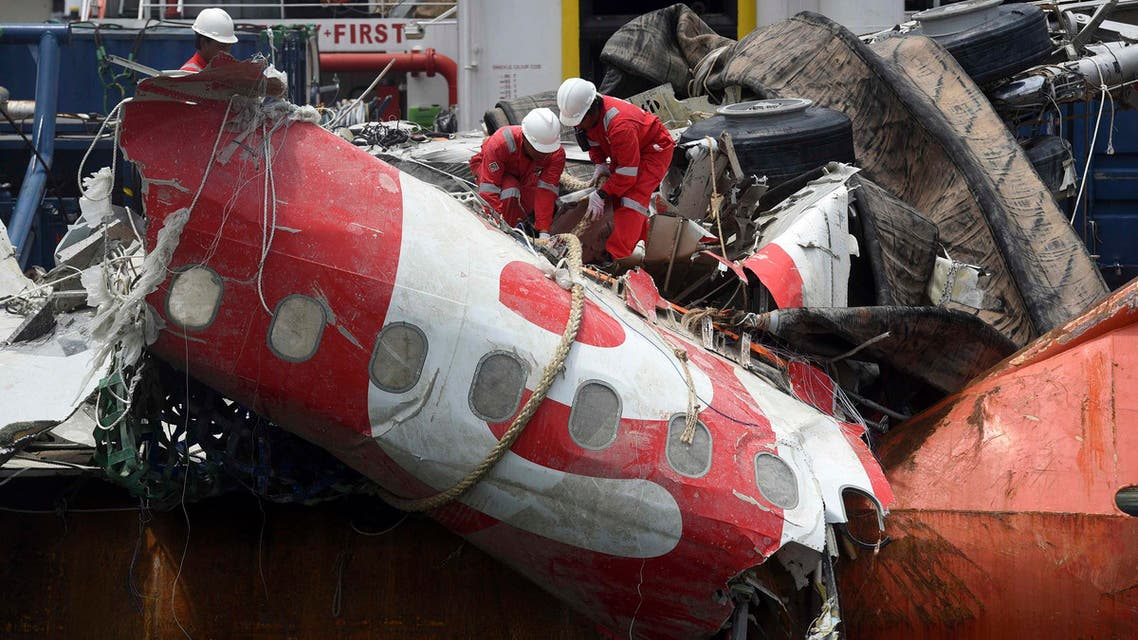 Workers prepare to unload the fuselage of AirAsia QZ8501, which crashed into the Java Sea on Dec. 28, from the ship Onyx Crest in Tanjung Priok port in Jakarta March 2, 2015. (Reuters)