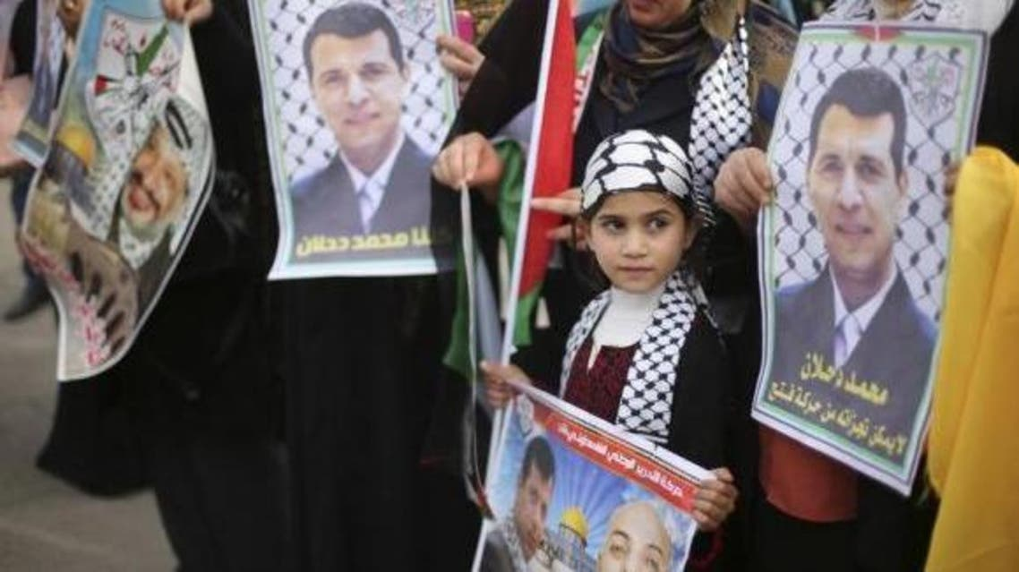 Palestinian supporters of former head of Fatah in Gaza, Mohammed Dahlan, hold posters depicting Dahlan (R) during a protest against Palestinian President Mahmoud Abbas in Gaza City December 18, 2014. (Reuters)