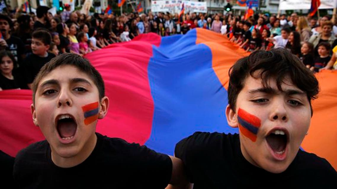 Armenian boys shout slogans against Turkey in front of a huge Armenian flag during a demonstration near the Turkish embassy in central Athens, April 24, 2013. (File: Reuters)