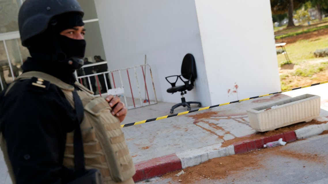 A policeman guard the entrance of the Bardo museum in Tunis, Tunisia, Thursday, March 19, 2015, as a a blood stain is seen at right, a day after gunmen opened fire killing over 20 people, mainly tourists. (AP)