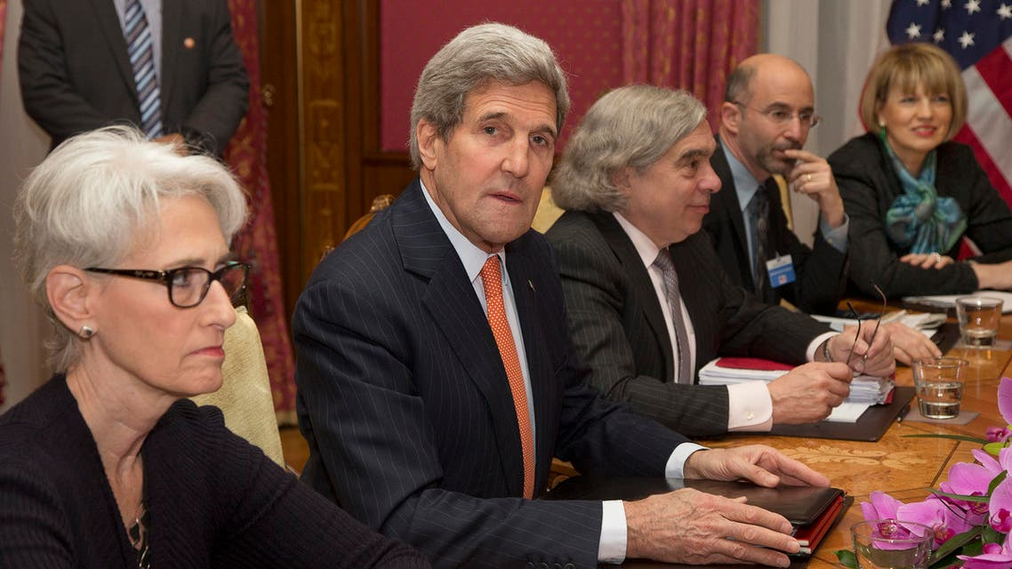 US Secretary of State John Kerry, centre, sits at the negotiating table with U.S. Under Secretary for Political Affairs Wendy Sherman, left and from centre right, U.S. Secretary of Energy Ernest Moniz, Robert Malley and from the U.S. National Security Council and European Union Political Director Helga Schmid during a meeting with Iran's Foreign Minister Javad Zarif over Iran's nuclear program, in Lausanne, Switzerland, Thursday, March 19, 2015. AP
