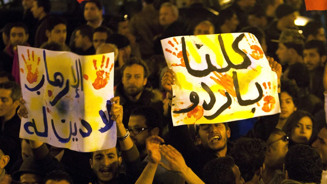 Tunisians gather at Habib Bourguiba avenue to show solidarity with the victims of the attack at a museum in Tunis, Wednesday, March 18, 2015. (AP)