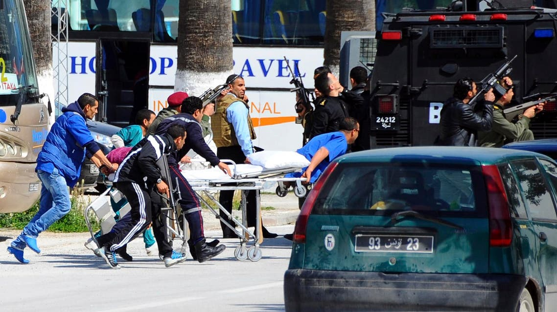 Escorted by security forces, rescue workers pull an empty stretcher outside the Bardo museum Wednesday, March 18, 2015 in Tunis, Tunisia. (AP)