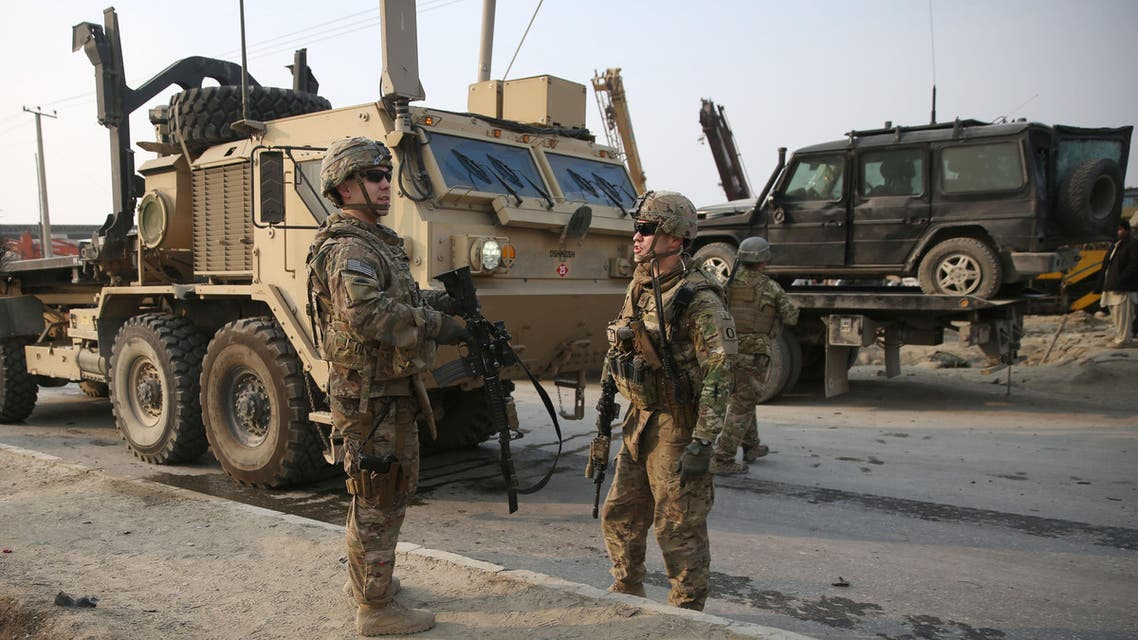 U.S. and British soldiers talk at the site of a suicide car bomb attack in Kabul, Afghanistan Monday, Jan. 5, 2015. AP