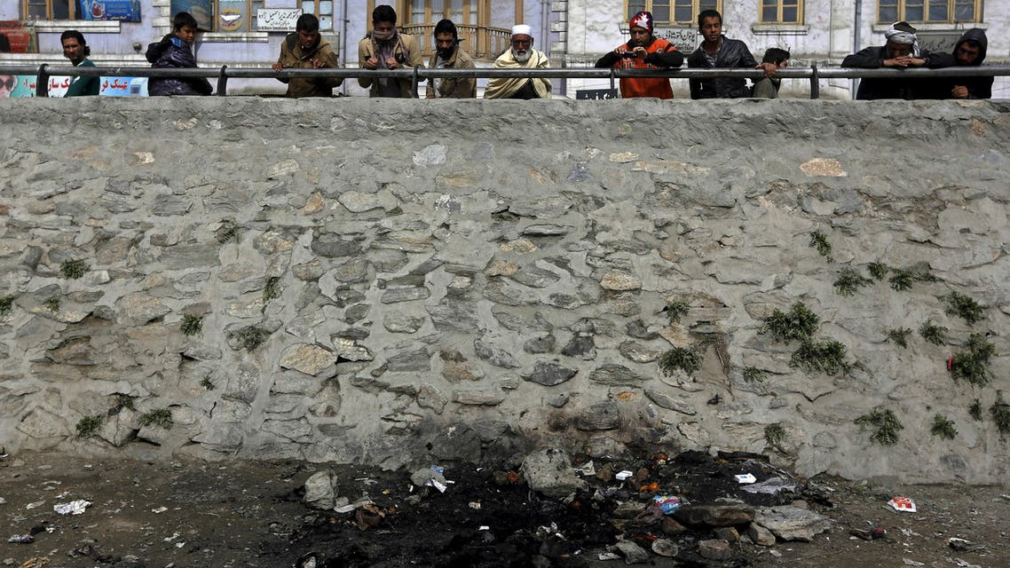 Afghan men look at the site where an Afghan woman was beaten to death and her body set on fire in Kabul, March 20, 2015. (Reuters)