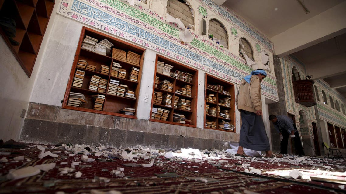 A Houthi militant walks after a suicide bomb attack at a mosque in Sanaa March 20, 2015. (Reuters)