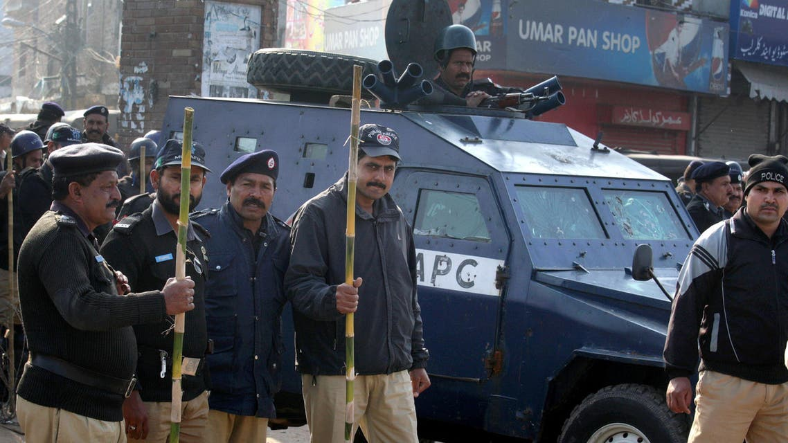 Pakistani police officers stand guard close to the venue of a mass funeral service of the victims of Sunday's pair of suicide attacks on two churches in Lahore, Pakistan, Tuesday, March 17, 2015. (AP)